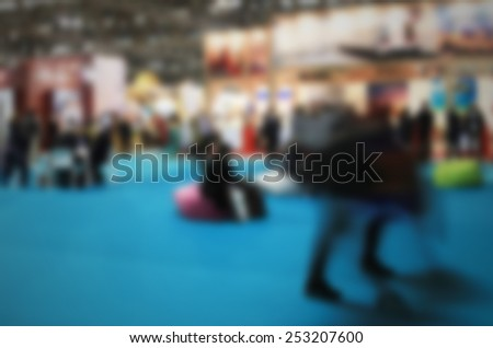 People at trade show. Intentionally blurred, editing post production.