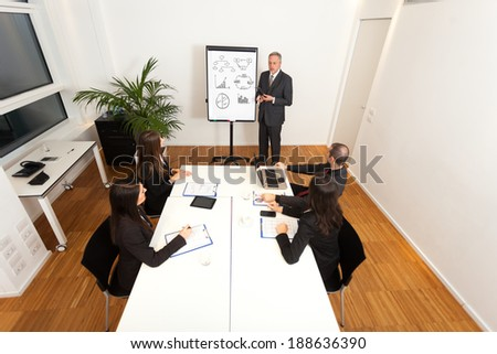 People at work during a meeting - stock photo