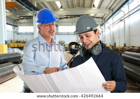 People at work in a factory - stock photo