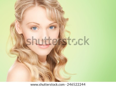people, beauty, body and skin care concept - beautiful woman face and hands over green background - stock photo