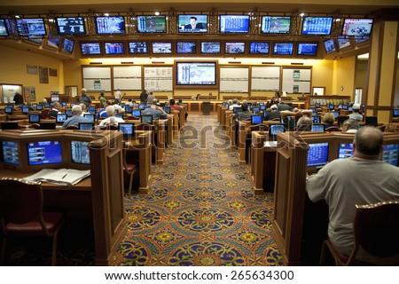 People betting on horse race, South Point Casino, Las Vegas, Nevada  - stock photo