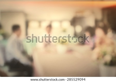 people blurred in meeting room - stock photo
