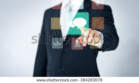 people, business, technology and communication concept - close up of man pointing finger to messenger icon projection - stock photo