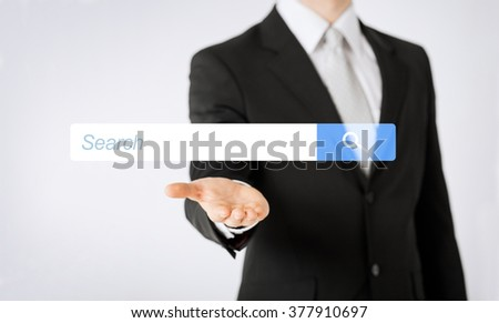 people, business, technology and networking concept - close up of man hand showing internet browser search bar projection