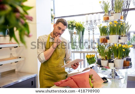 people, business, technology, sale and floristry and concept - florist man with tablet pc computer thinking at flower shop counter - stock photo