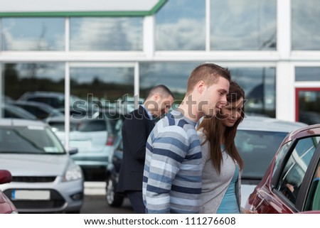 People buying a car in a dealership - stock photo