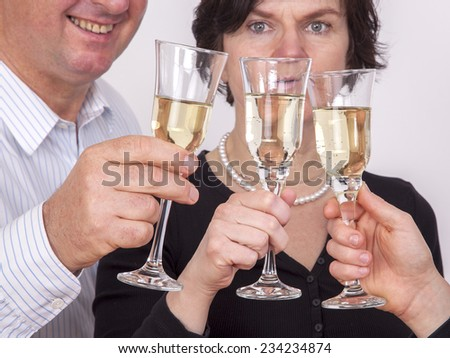 People celebrating with champagne your success - stock photo