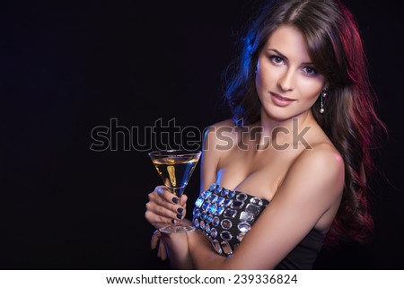 People celebration concept. Closeup of woman with glass of cocktail over dark background - stock photo