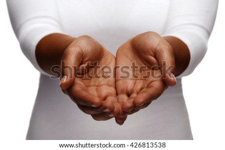 people, charity and poverty concept - close up of african american female empty cupped hands holding and showing something - stock photo
