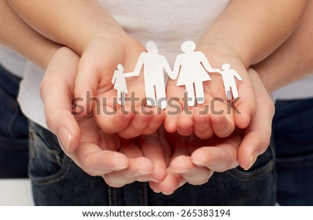people, charity, family and care concept - close up of woman and girl hands holding paper family cutout - stock photo