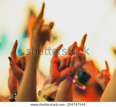 People cheering at rock festival - stock photo
