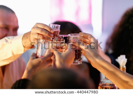 People cheers with wineglasses - stock photo