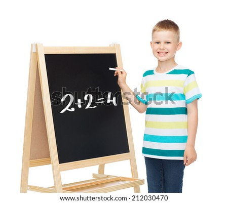 people, childhood and education concept - smiling little boy with blank blackboard over white background - stock photo