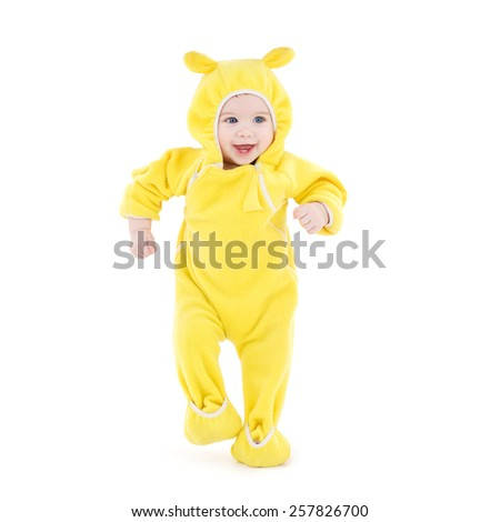 people, children, achievement and happiness concept - happy baby in yellow suit making first steps - stock photo
