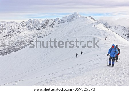People climbing on Kasprowy Wierch in Zakopane on Tatras in winter.  Zakopane is a town in Poland in Tatra Mountains. Kasprowy Wierch is a mountain in Zakopane and the most popular ski area in Poland
