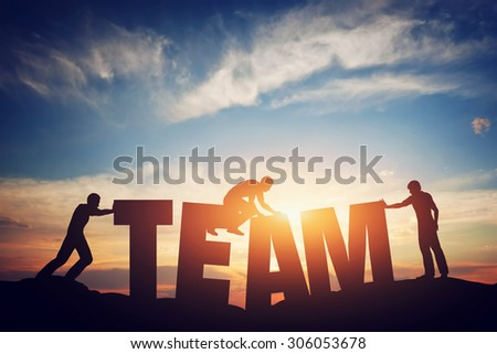 People connect letters to compose the team word. Teamwork concept, idea. Sunset positive light. - stock photo