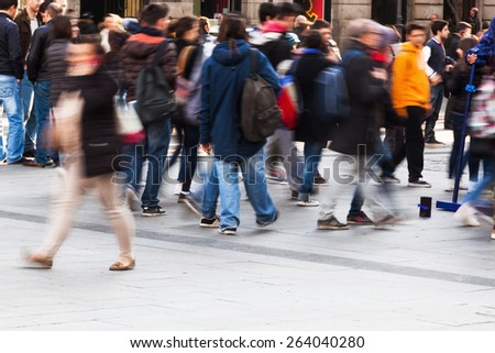 people crossing a city street - stock photo
