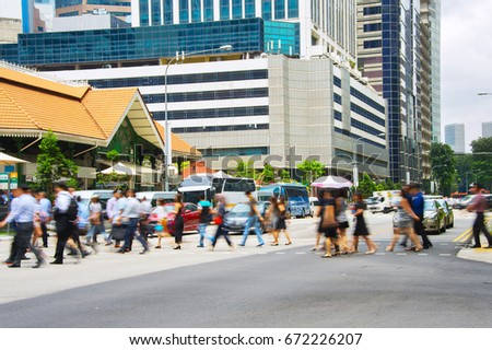 People crossing a road in Singapore business downtown