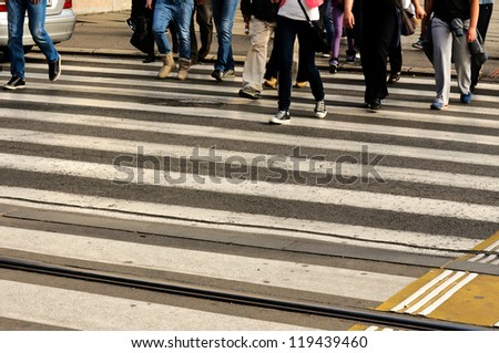 People crossing the pedestrian crossing - stock photo