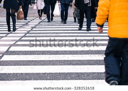 people crossing the road in japan