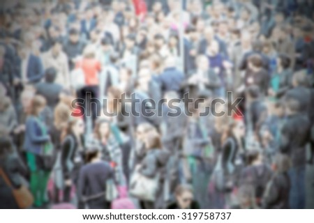 People crowd generic background, intentionally blurred post production.