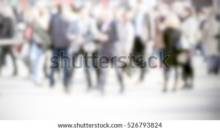 People crowd, generic background with an intentional blur effect applied. Humans and location unrecognizable.