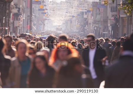 people crowd walking on busy street on daytime - stock photo