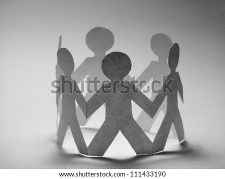 People cut out of paper in black and white style - stock photo