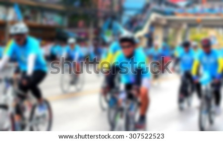 People cycling together in the event BIKE FOR MOM(Blur image of asphalt road and bike for background usage)