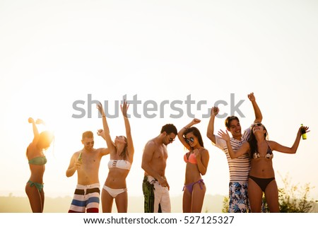 People dancing and partying in summer