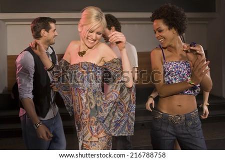 People dancing at a nightclub. - stock photo