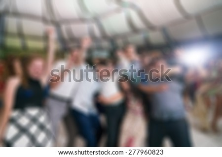 People dancing at the party abstract blur background with bokeh