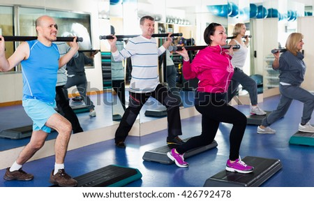 People do aerobics and crossfit in a sport club - stock photo