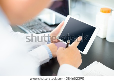 people doing chemical experiment in modern lab - stock photo