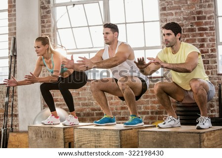 People doing plyo box exercise at the gym - stock photo