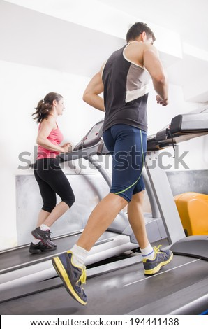 People doing running exercise with the treadmill - stock photo