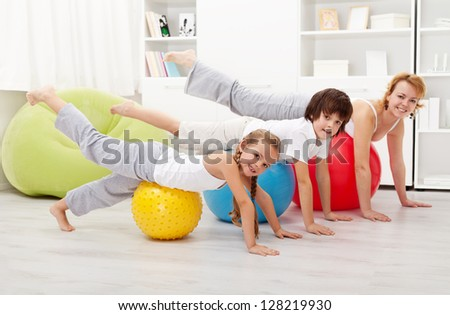 People doing stretching exercises using gymnastic balls - stock photo