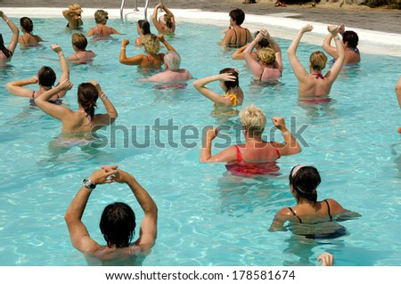 People doing water aerobic in pool - stock photo
