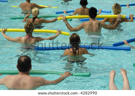 People doing water aerobic in pool - stock photo