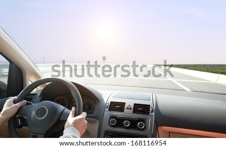 people Driving on road under sunshine - stock photo