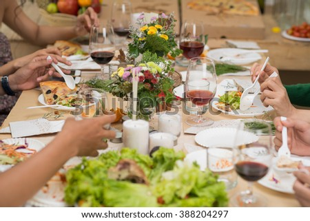 People eating at decorated dinner table