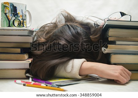 people, education, session, exams and school concept - tired student girl or young woman with books sleeping  - stock photo