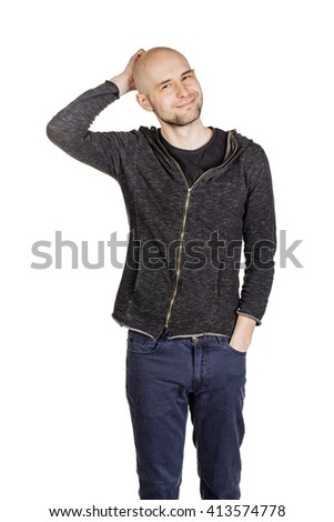 people, emotion and lifestyle concept - bald young man scratching his head - stock photo