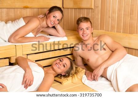 People enjoying a day in the wellness sauna - stock photo