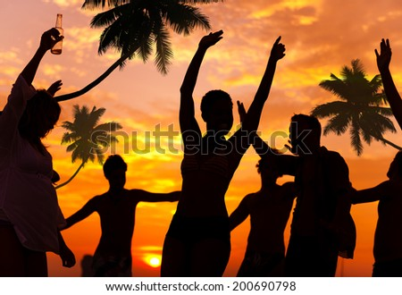 People Enjoying Party by the Beach - stock photo