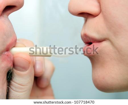 people enjoying smoking marijuana joint closeup - stock photo