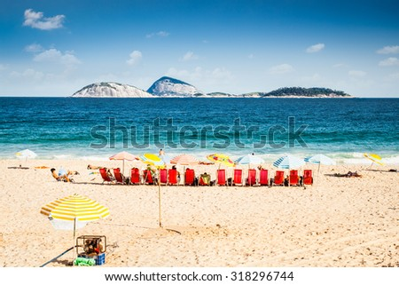 People enjoying  the beautiful Ipanema beach in Rio de Janeiro. Brazil. - stock photo