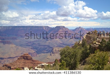 People Enjoying the View of the Grand Canyon - stock photo
