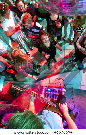 People enjoying themselves in a nightclub with live music - stock photo