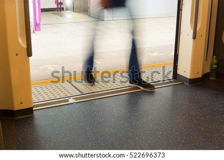 People Enter or Walk on Train or Subway, Abstract Motion Blur Defocus Background.